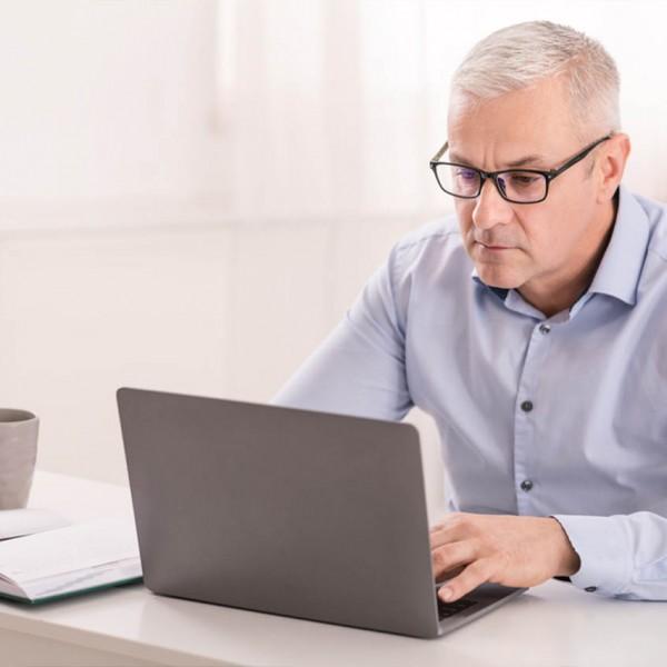 serious-senior-man-using-laptop-at-home-office-SFG2XGU_Easy-Resize.com_